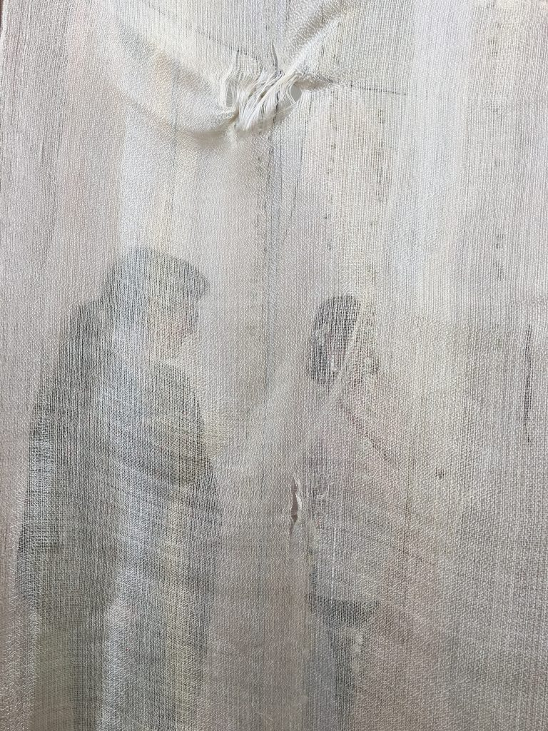 Lady Behind Hanging Cloth