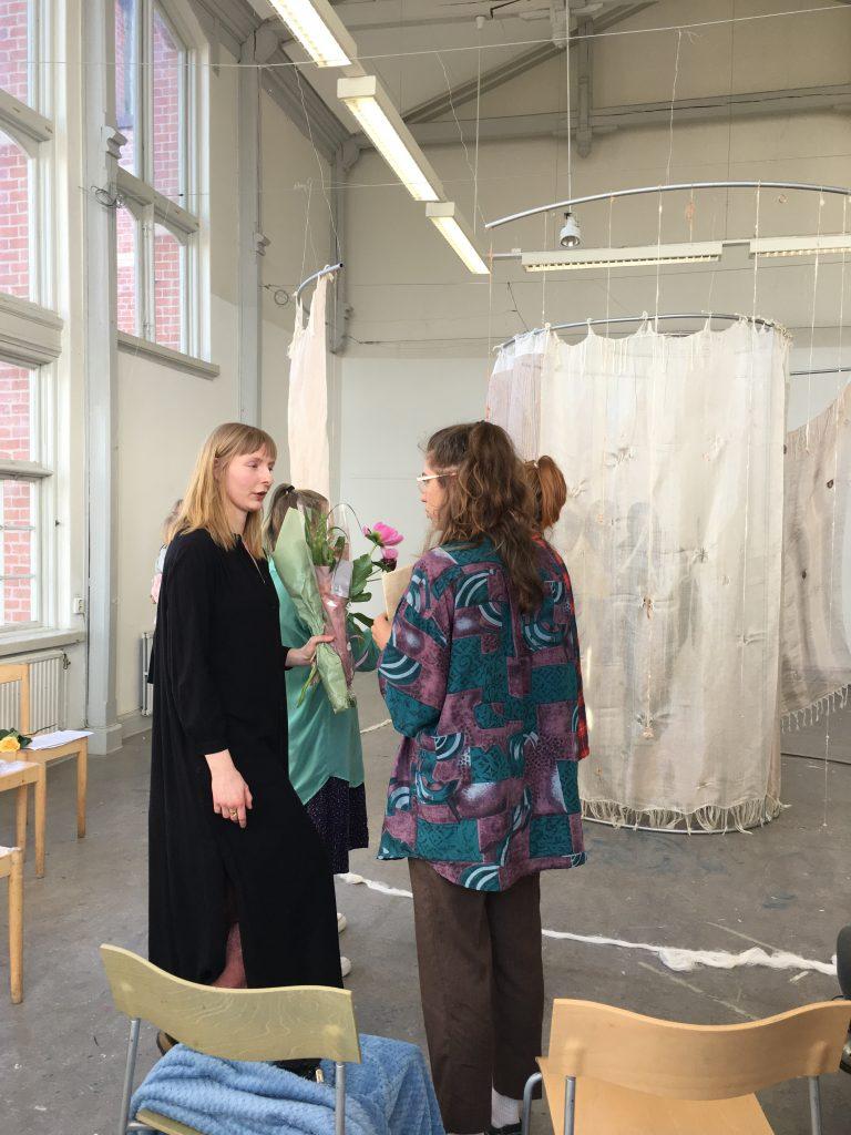 Girl Standing Near Fabric Hanging