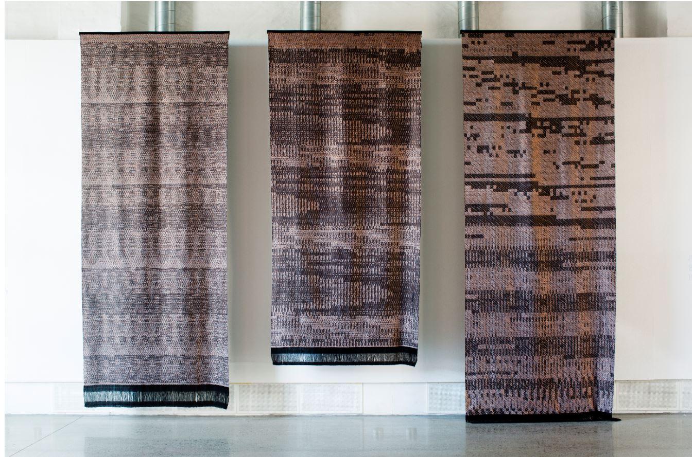 Three Fabric Cloths Hanging